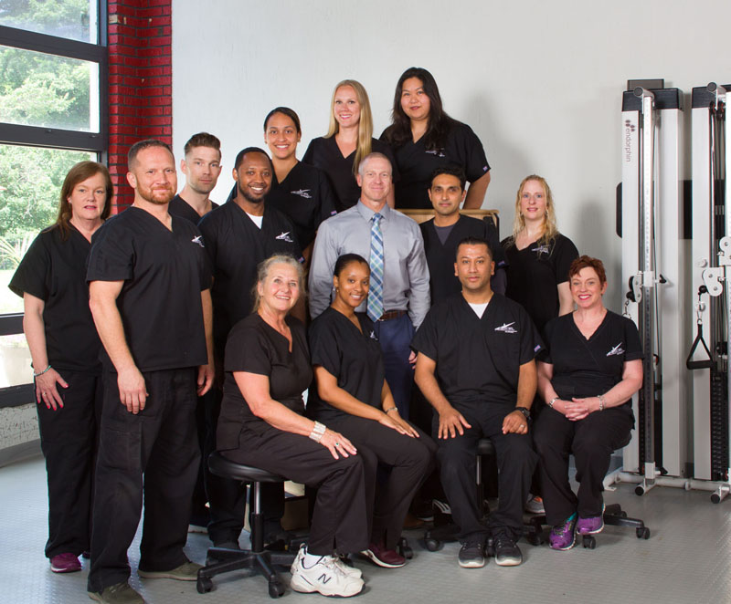 Physical therapy staff in gym at Excel on Long Island